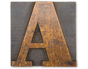 Antique wood cut block of the letter A