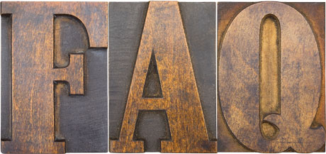 Antique wood cut block of the letters F, A, and Q